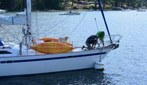 Sailboat dropping anchor.