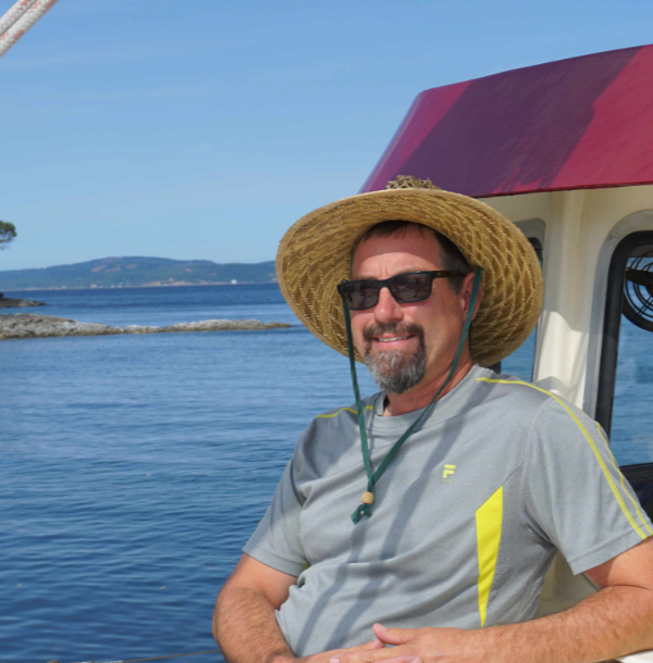 Mike Beemer relaxing on boat